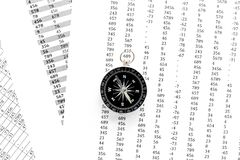 Compass on documents background top view copy space. Black and white, contrast.  Royalty Free Stock Images