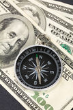 Compass and dollar Stock Photography