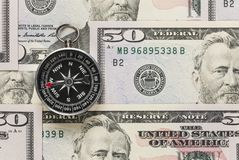 Compass and dollar. Compass on dollar banknote. Macro shot of a 50 dollar. Dollars Closeup Concept. American Dollars Cash Money royalty free stock photo