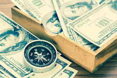 Compass and dollar bills, vintage style Royalty Free Stock Image