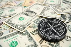 Compass on the dollars. Stock Photos
