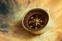 Compass with dramatic sky background. Stock Images