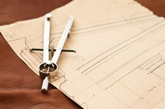Compass and Drawing Royalty Free Stock Photos