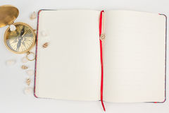 Compass with empty pages notebook. Stock Photos