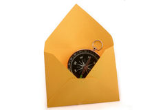 Compass in envelope. Compass in a an envelope on a white background Stock Photography