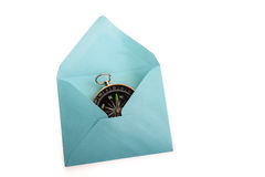 Compass in envelope. Compass in a an envelope on a white background Royalty Free Stock Photos