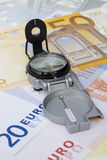 Compass on euro banknotes Stock Images
