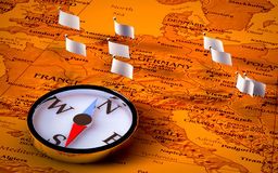 Compass on European map with flags Stock Photo