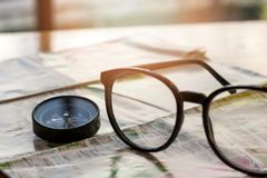 Compass and eye glasses Stock Image