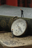 Compass with figurine and book, close up Stock Photography