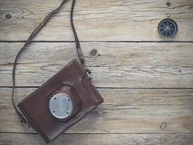 Compass and film camera Royalty Free Stock Photo