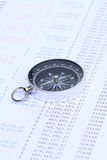 Compass on financial statement. A black compass placed on a bank statement stock photos