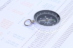Compass on financial statement. A black compass placed on a bank statement royalty free stock photo