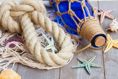 Compass on fishing net Royalty Free Stock Image