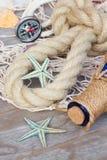 Compass on fishing net Royalty Free Stock Photo