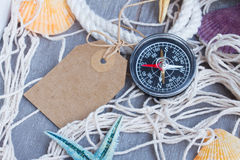 Compass on fishing net with tag Stock Photography