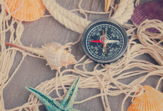 Compass on fishing net with tag Royalty Free Stock Image