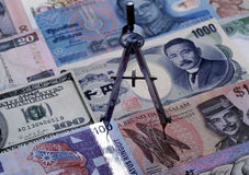 Compass on foreign currency Stock Images