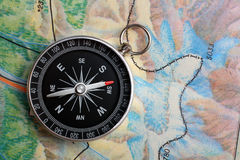 Compass on geography map stock photos