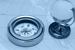 Compass and glass globe. The device for the instruction of a direction and a card Royalty Free Stock Photo