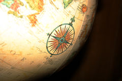 Compass on the Globe Stock Images
