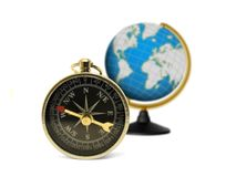 Compass and globe Stock Photography