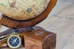 Compass and globe. Travel concept: Old compass, wooden globe and box with anchor sign Stock Image