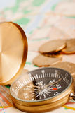 Compass and golden coins Royalty Free Stock Images