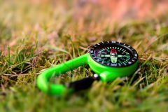 Compass on the grass close up outdoors concept Stock Image