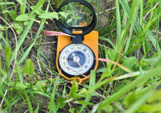 Compass in the grass. Stock Image
