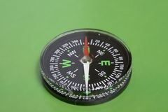 Compass on green Stock Photography