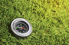 Compass on green grass Stock Images