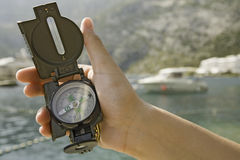 Compass in hand Stock Photography