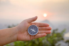 Compass in hand. Hand holding the compass in sunset Stock Photos