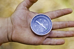 Compass on a hand. Royalty Free Stock Photo