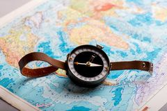 Compass in hand against the background of a bright world map royalty free stock images