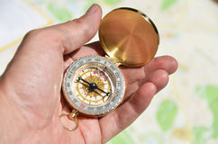 Compass in the hand Royalty Free Stock Image