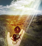 Compass in the hand Stock Photography