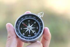 Compass on hand Stock Photos