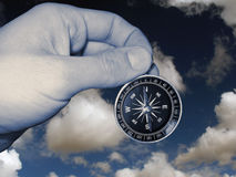 Compass in hand isolated. Compass in hand geographical, cartography, cartographical tools, insulated, sky background, for designer Stock Photos