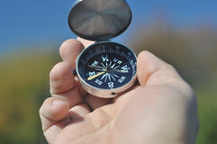 Compass in hand. Royalty Free Stock Image