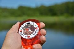 Compass in hand. Stock Image