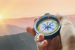 Compass and hand in mountains Royalty Free Stock Image