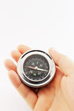 Compass and hand Royalty Free Stock Photography
