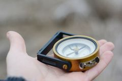 Compass in hand. Student make choice in his future, life direction to success. Royalty Free Stock Image