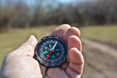 Compass in the hand on a walk. Stock Photography