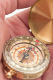 Compass in hands Royalty Free Stock Images