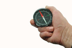 Compass held in the hand. On a white background Royalty Free Stock Image