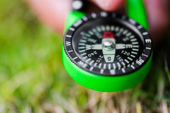 Compass held in hand pointing south direction concept stock image