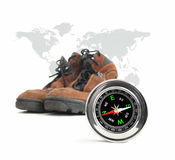 Compass and hiking shoes Royalty Free Stock Image